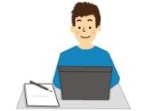 パソコンで作業をしている青年のイラスト